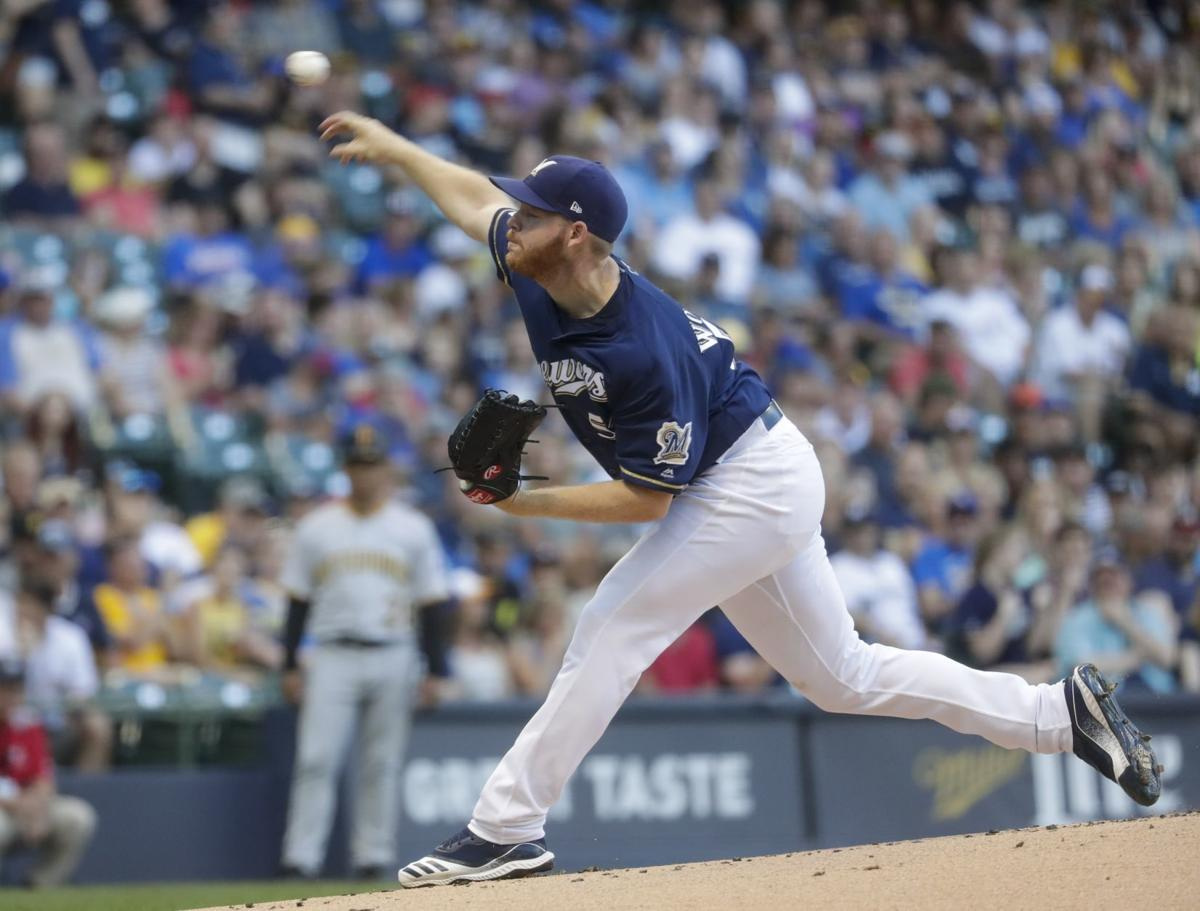Brandon Woodruff pitches, AP photo