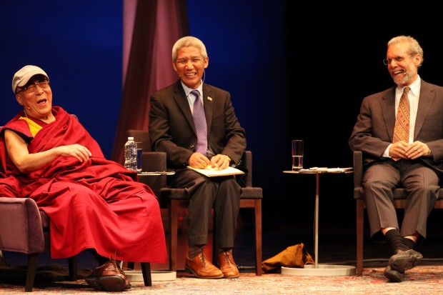 Dalai Lama reacts with laughter during panel discussion