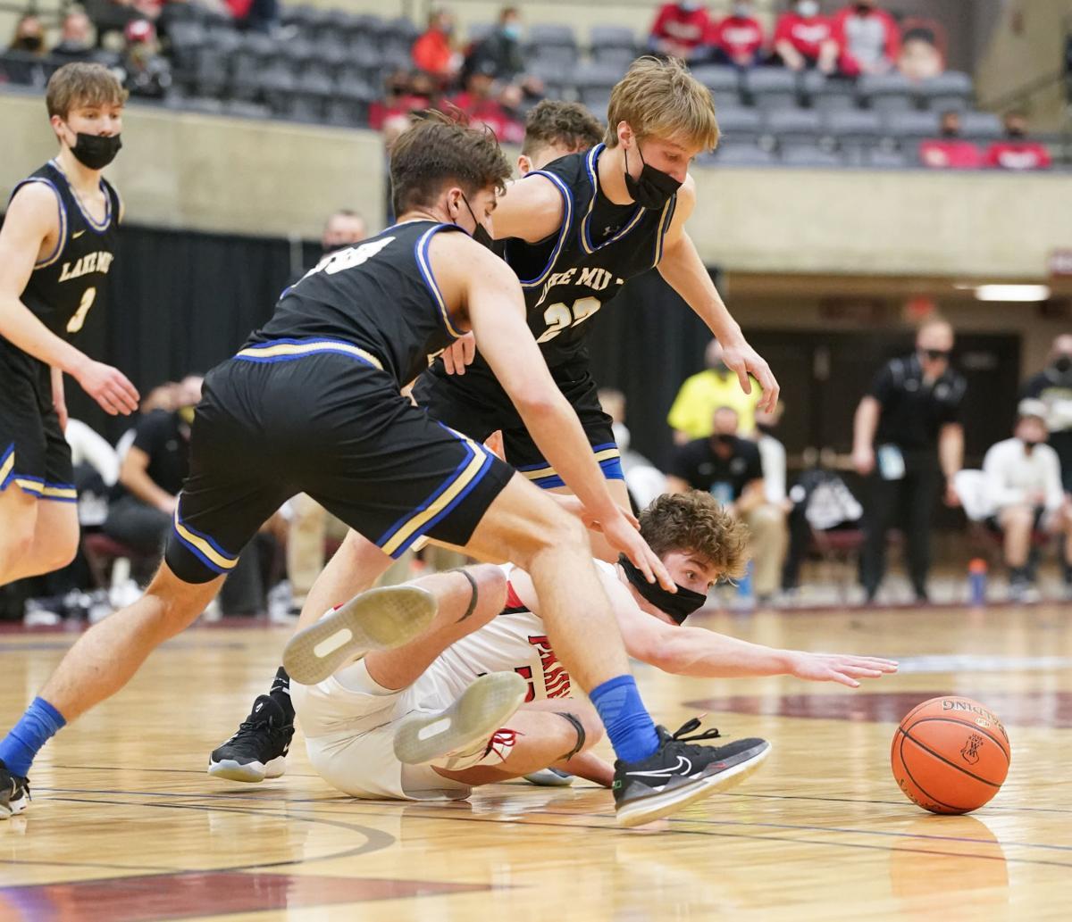 WIAA boys basketball photo: Lake Mills' Jaxson Retrum and Charlie Bender chase a loose ball