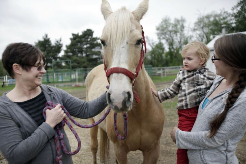 Sandi with horse, grandson, daughter-in-law