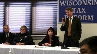 Scott Walker budget extends funding for extra tax collectors