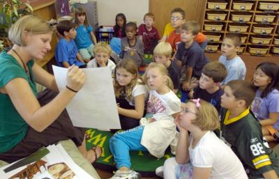 full elementary classroom with teacher file photo