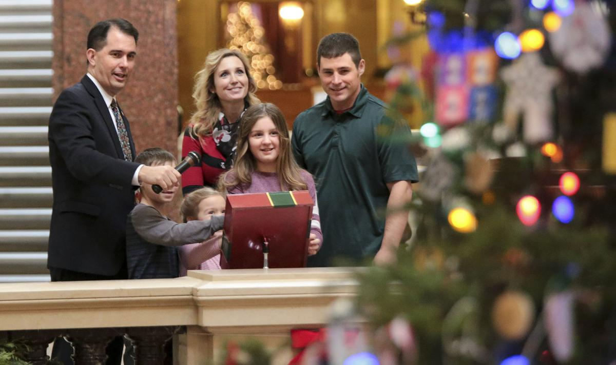 Light it up! Scott Walker ushers in the holiday season at the state Capitol