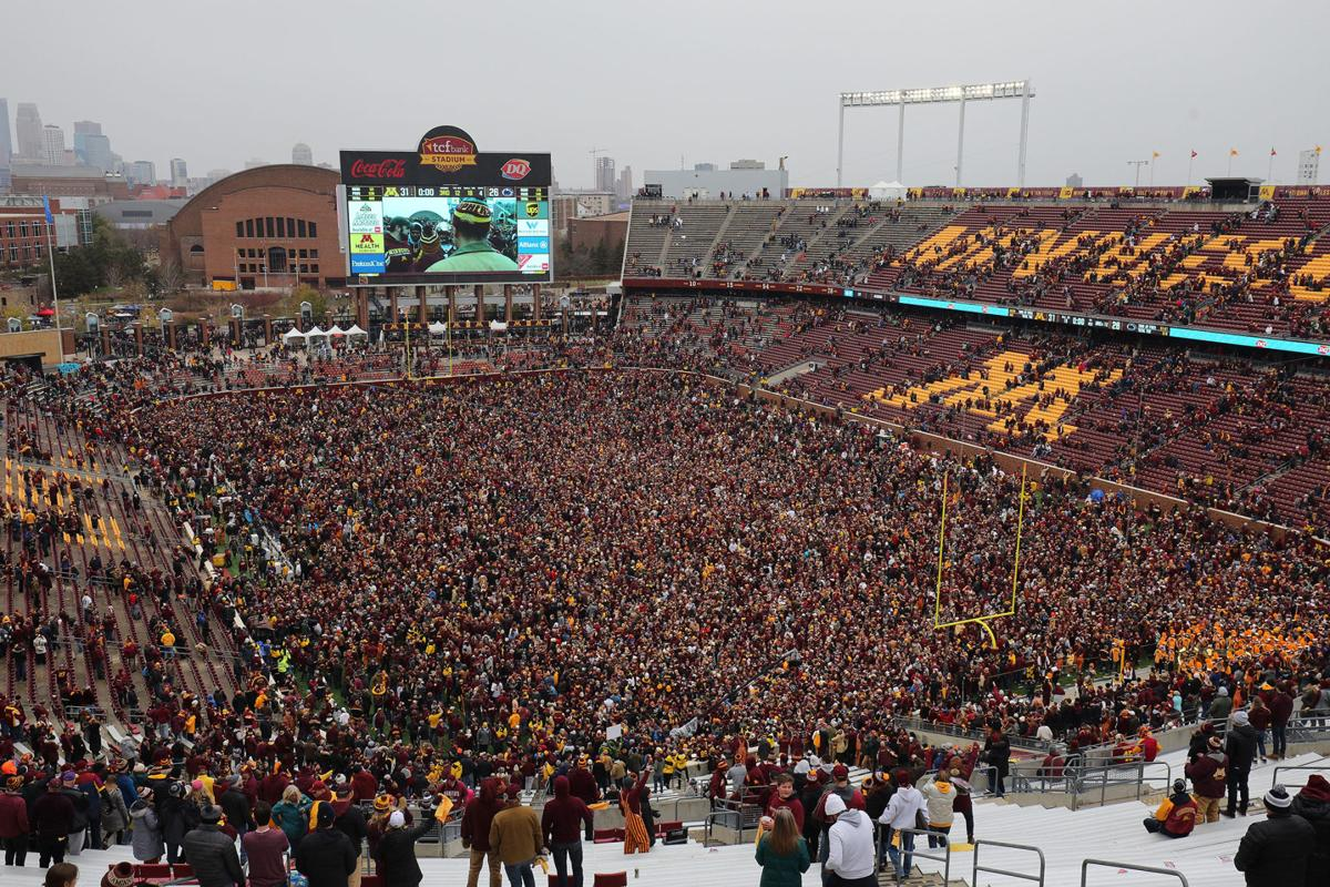 Minnesota Golden Gophers and fans storm the field while hoisting the Governor's Victory Bell after defeating the Penn State Nittany Lions 31-26 to remain undefeated at TCFBank Stadium on November 9, 2019 in Minneapolis, Minnesota.