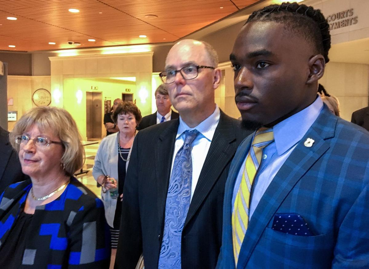 Quintez Cephus in court with lawyers, State Journal photo