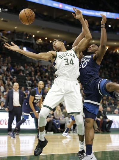da78d3c5dd7 Giannis battles for ball. Bucks forward Giannis Antetokounmpo ...