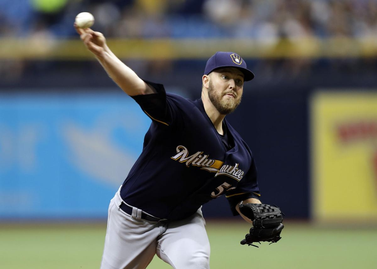 Jimmy Nelson pitching, AP photo