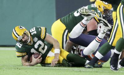 Aaron Rodgers injured against Bears, State Journal photo