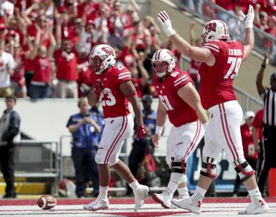 Taylor and linemen-offensive line hitting stride (copy)