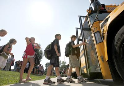 Kids getting on school bus, State Journal generic file photo