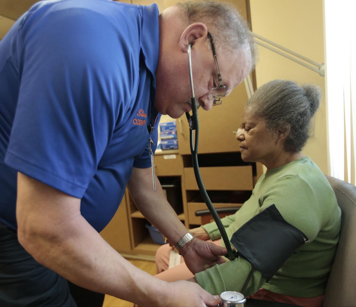 Steve Zank takes Priscilla Dunbar's blood pressure