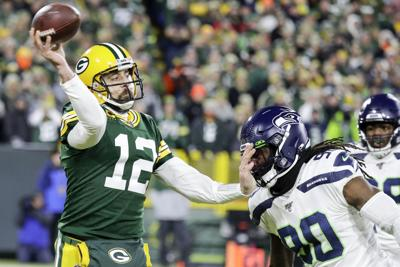 Aaron Rodgers passes against Seahawks, AP photo