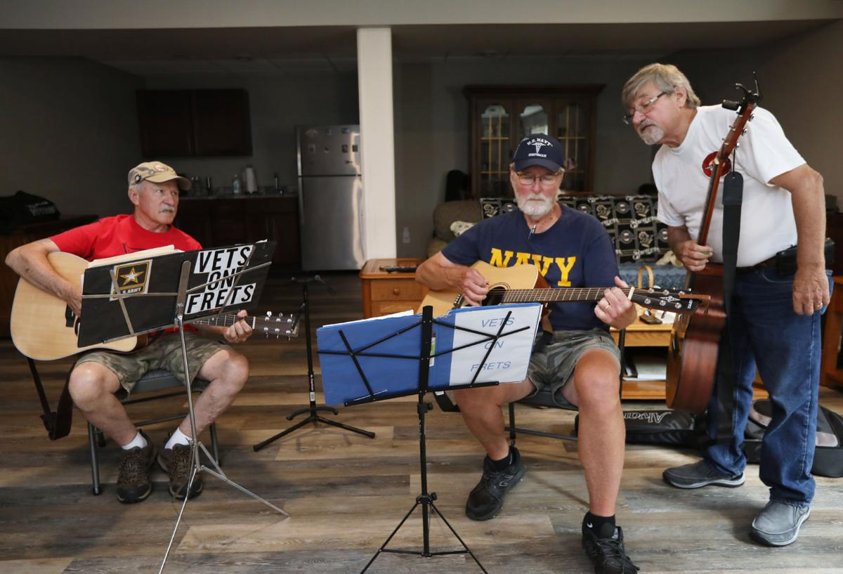 Vets on Frets work on song during reherasal