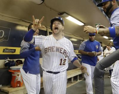 fa50ad6f8aa23 Milwaukee Brewers catcher Stephen Vogt celebrates after hitting a home run  during the second inning of a game against the Chicago Cubs on Sept.