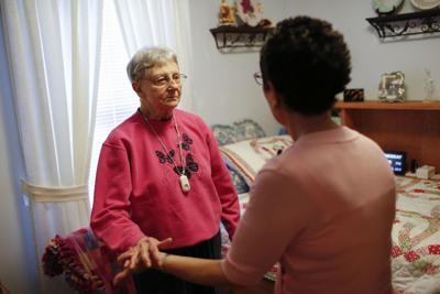 Martha Hays, left, works July 19 with nurse Sandy Miller