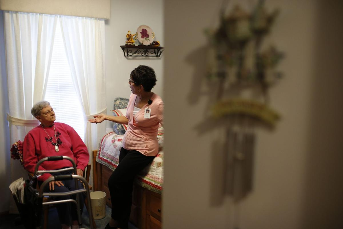 Nurse Sandy Miller, right, chats July 19 with patient Martha Hays (copy)