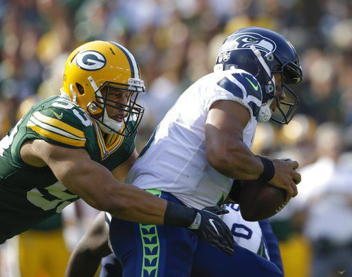 Nick Perry sacks Russell Wilson, AP photo