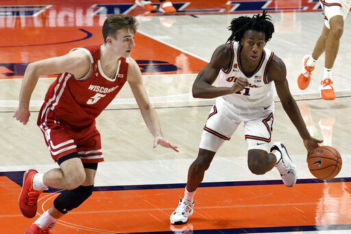 Ayo Dosunmu dribbles past Tyler Wahl, AP photo