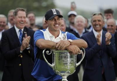 Brooks Koepka with Wanamaker Trophy, AP photo