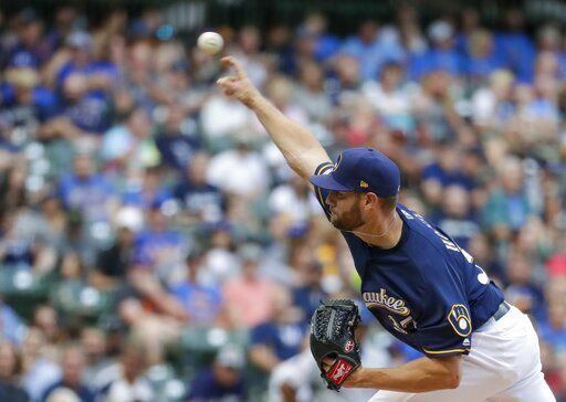 Adrian Houser throws, AP photo