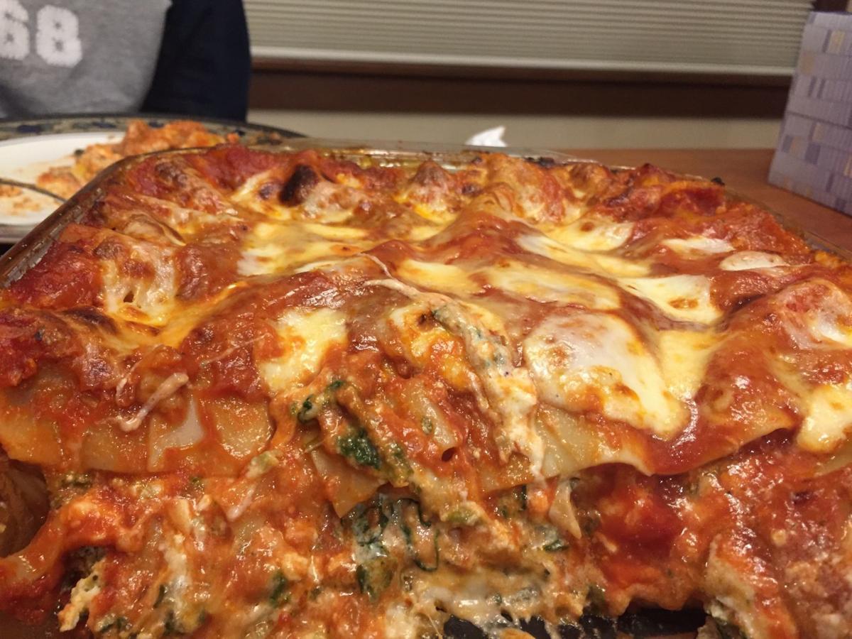 Lasagna closeup with tissues and son.jpeg
