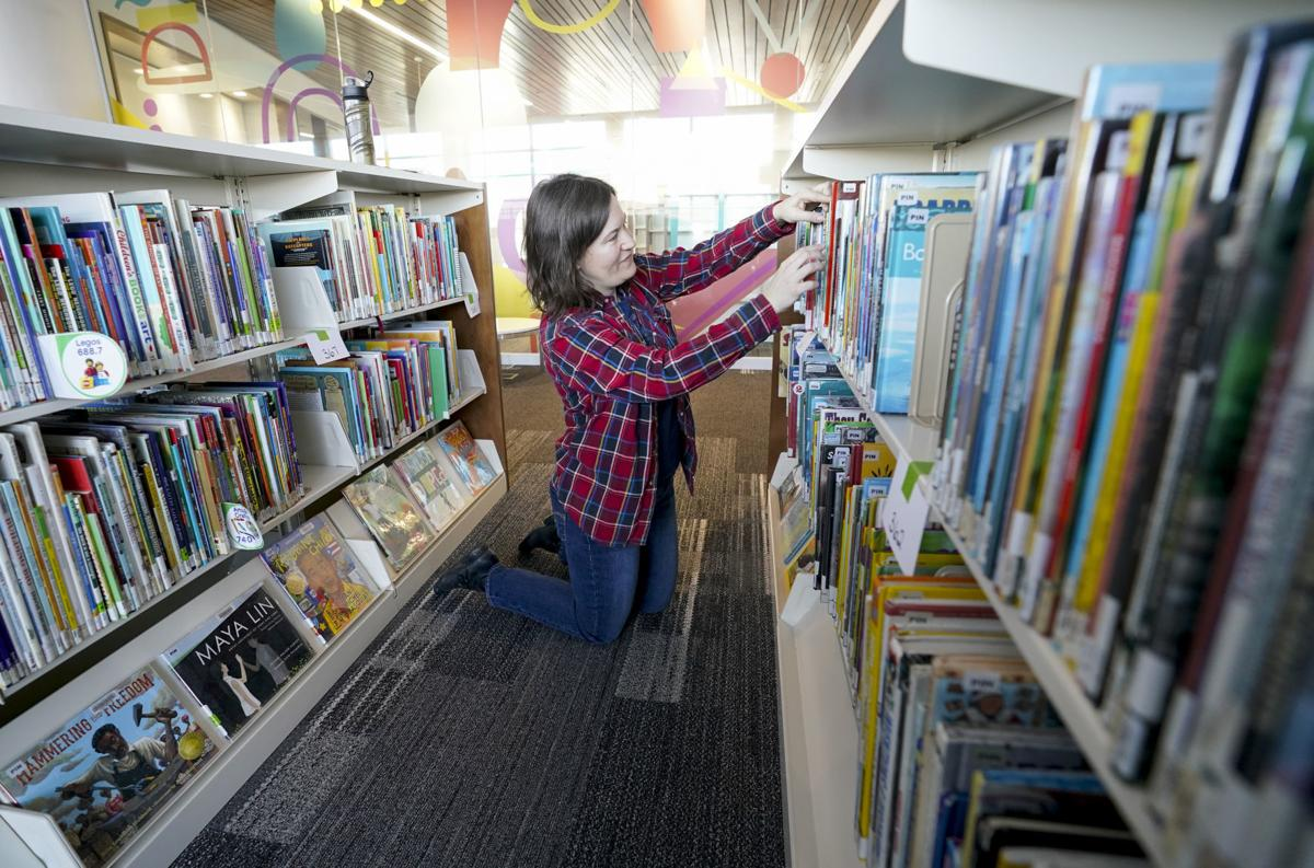 Pinney Library stacking books