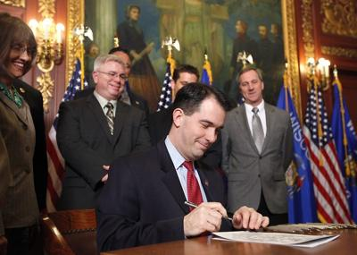 Walker signs collective bargaining bill file photo