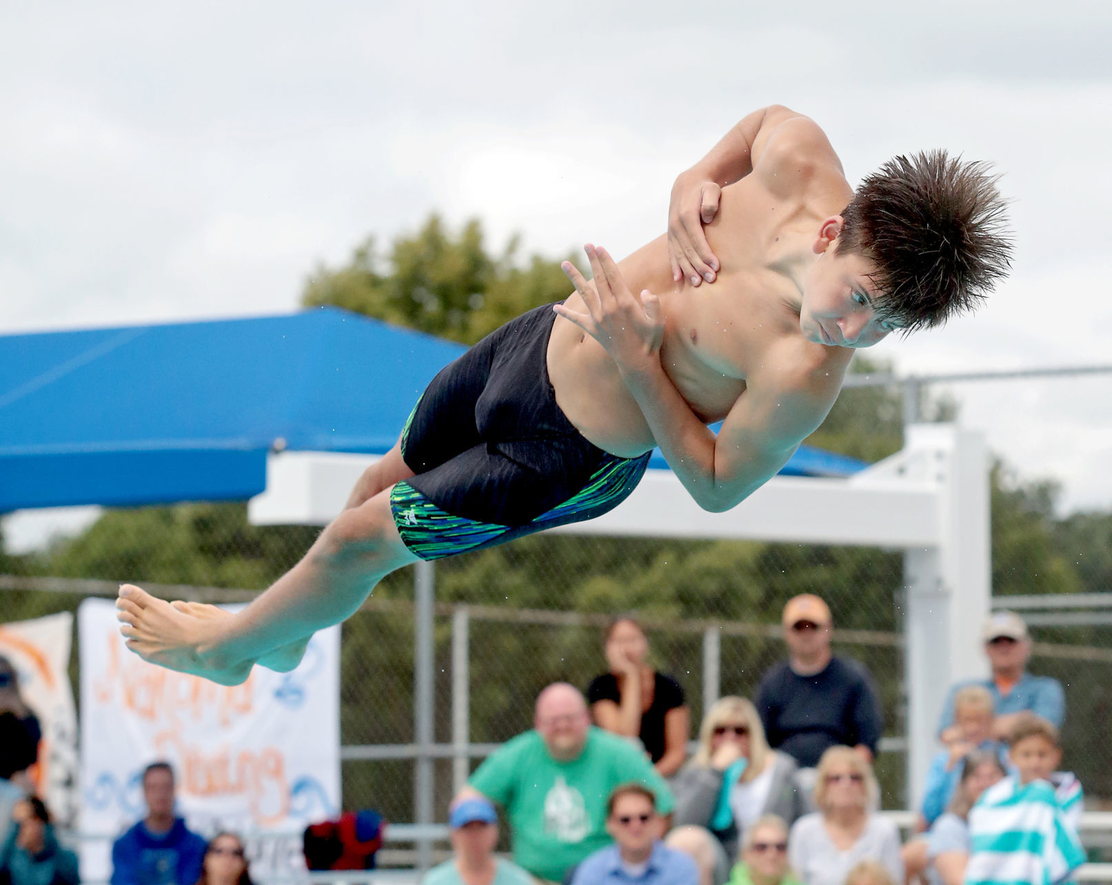 Prep boys diving photo: Madison Edgewood's Ben Stitgen