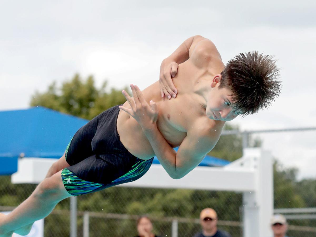 Prep boys diving photo: Madison Edgewood's Ben Stitgen