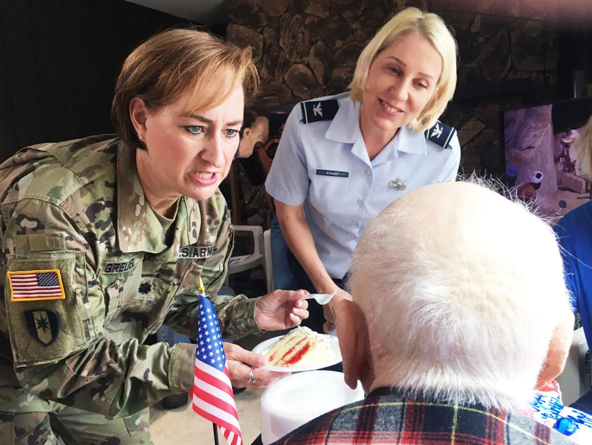 Darcie Greuel and Ann Knabe visit WWII veteran Roland 'Bud' Pater at 106th birthday