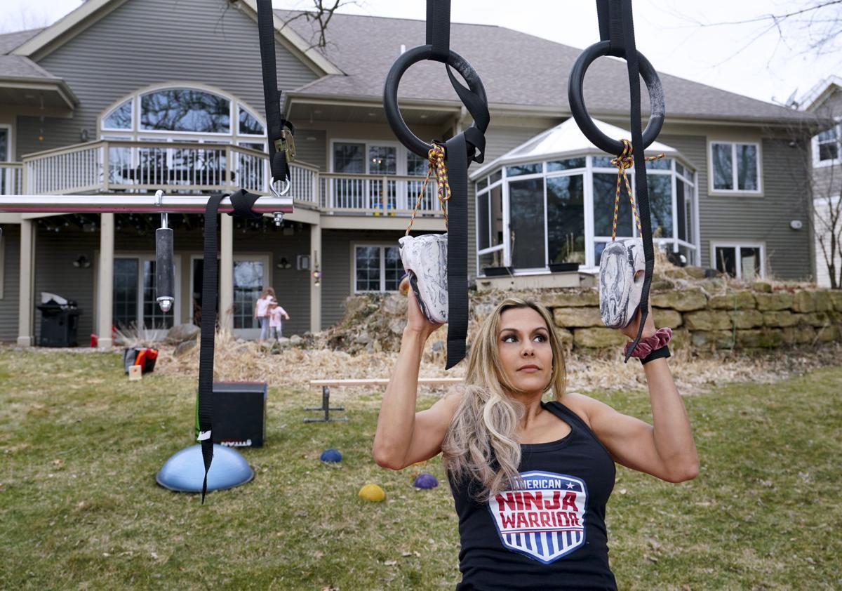 Yarizett Breunig with rings in back yard gym area