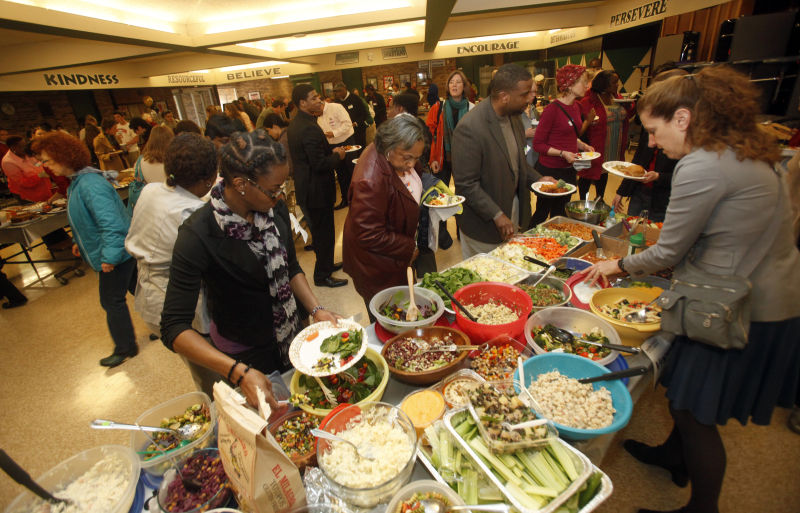 photos justified anger community potluck dinner at madison memorial