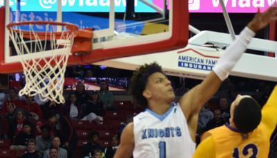 WIAA boys basketball photo: Nicolet's Jalen Johnson delivers a big block