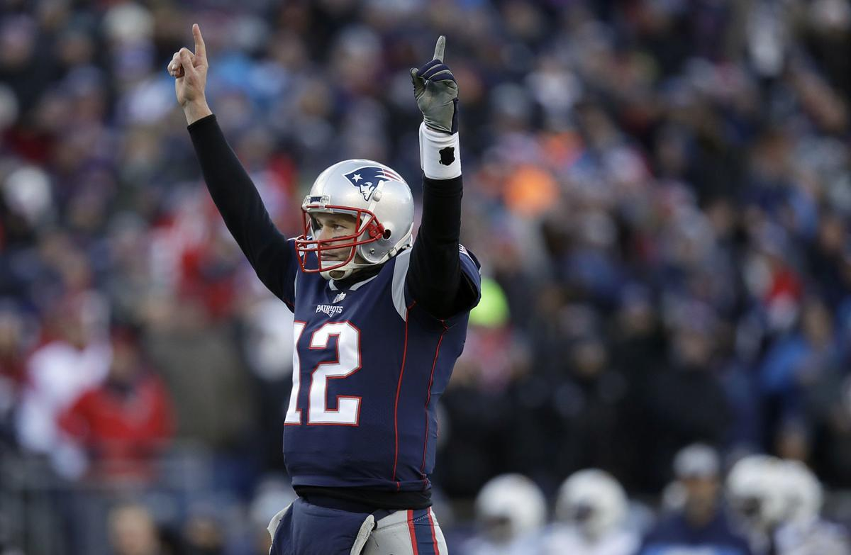 Tom Brady arms raised, AP photo