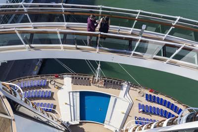 """Jorge Jimenez, 43, and his wife, Yomari Jimenez, 38, walk across the """"Bridge of Sighs"""" on MSC Cruises' newest ship, Seaside, as it was docked at PortMiami on Friday, Dec. 22, 2017. The cruise ship has various restaurants, digital displays adorning its atrium and a zipline among other amenities guests can enjoy."""
