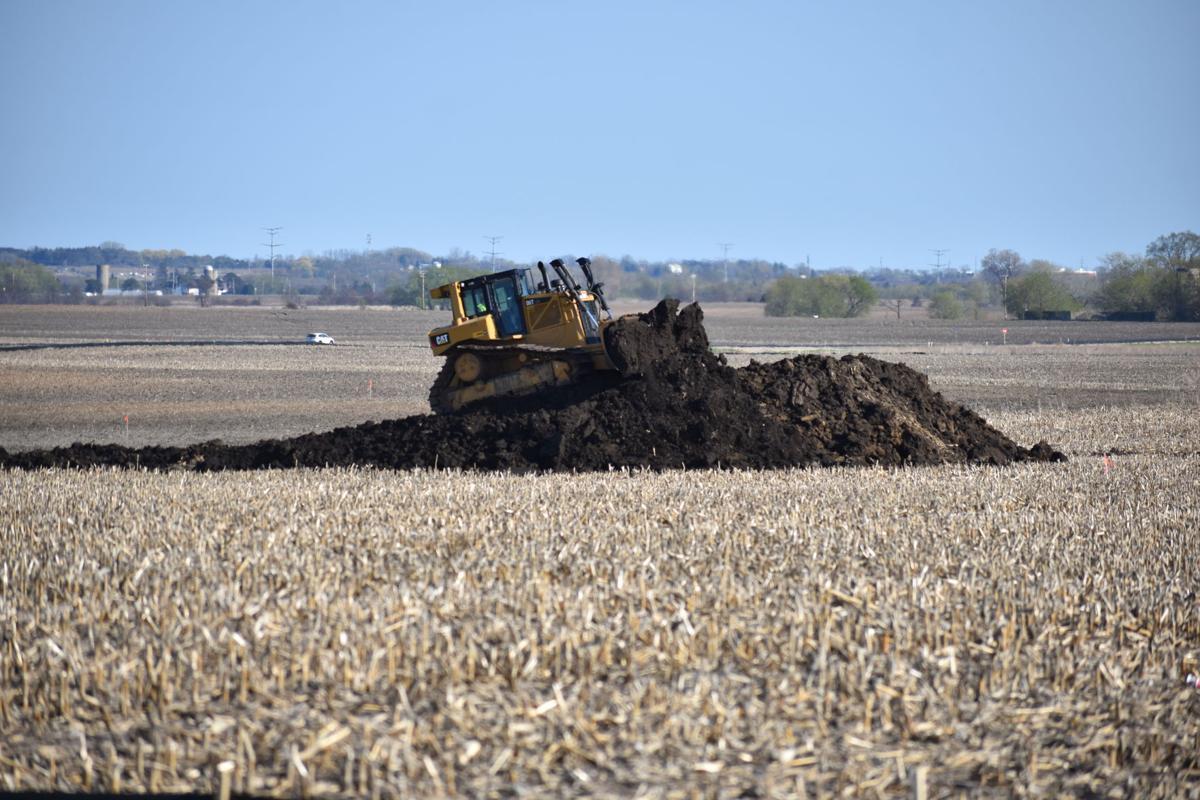 Pushing dirt on Foxconn land