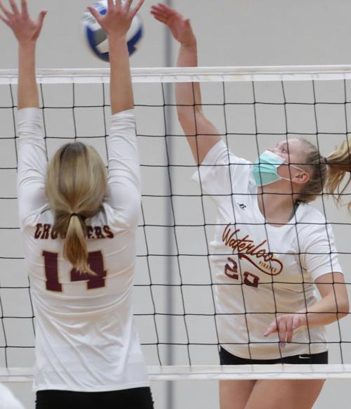 Prep sports photo: Players wear masks during Waterloo Invitational volleyball tournament