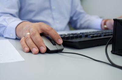 man uses computer keyboard mouse iStock photo illustration