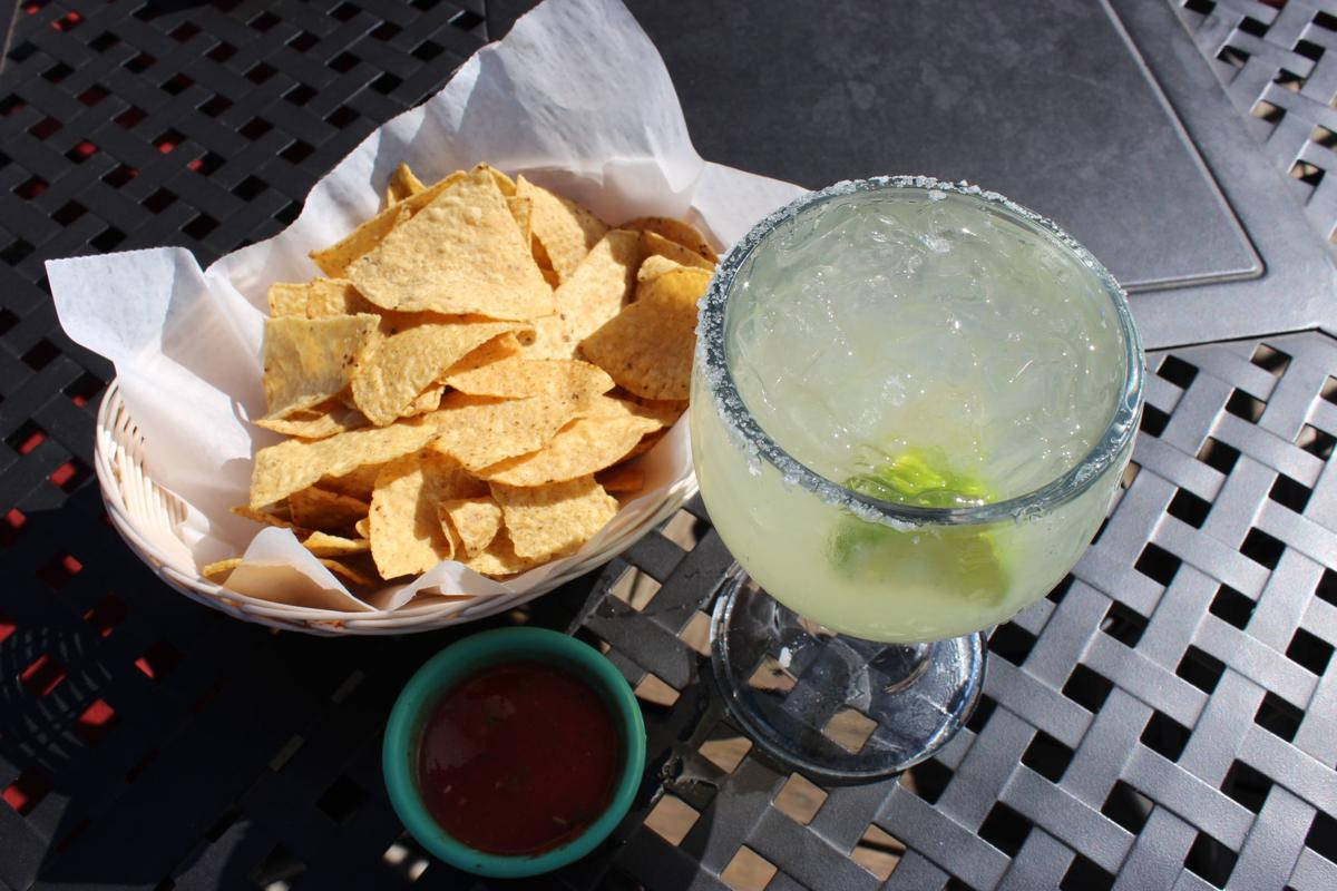 Chips and salsa with 16 oz Cadillac Margarita with Grand Marnier house mix, fresh lime juice, tequila and salt mixed together.  .JPG