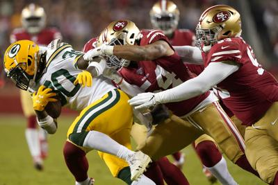 Jamaal Williams tackled by 49ers, AP photo