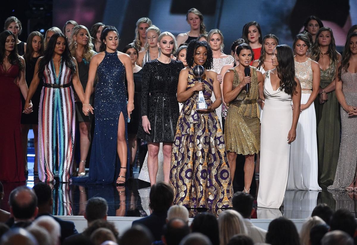Host Danica Patrick, Sarah Klein, Tiffany Thomas Lopez, Aly Raisman and recipients of the Arthur Ashe Award for Courage speak onstage at the ESPYS on July 18, 2018, at Microsoft Theater in Los Angeles. (Kevork Djansezian/Getty Images/TNS) **FOR USE WITH THIS STORY ONLY**