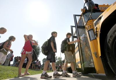 Kids getting on school bus, State Journal generic file photo (copy)