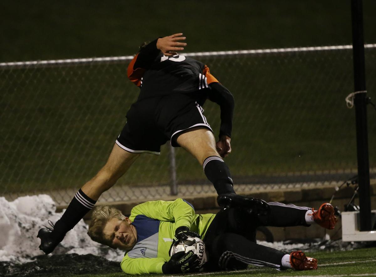 WIAA boys soccer photo: Verona's Jack Knight has his shot saved by Neenah's Ian Bogan