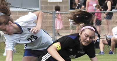 WIAA girls soccer photo: Waunakee's Maddie Farnsworth battles for control