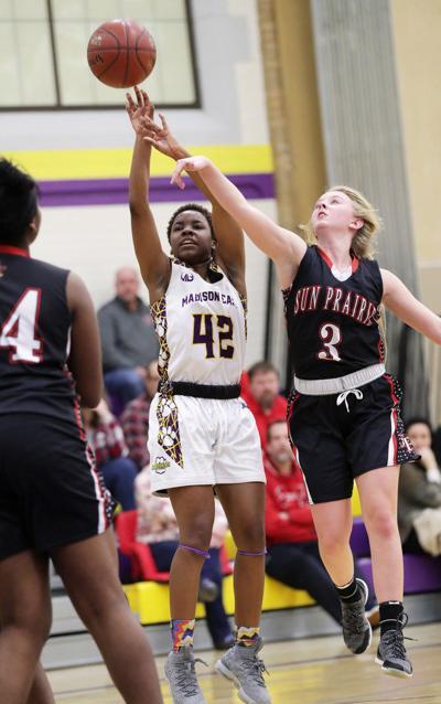 Prep girls basketball photo: Sun Prairie's Grace Hilber defends against East's Alonna Harvey-Williams