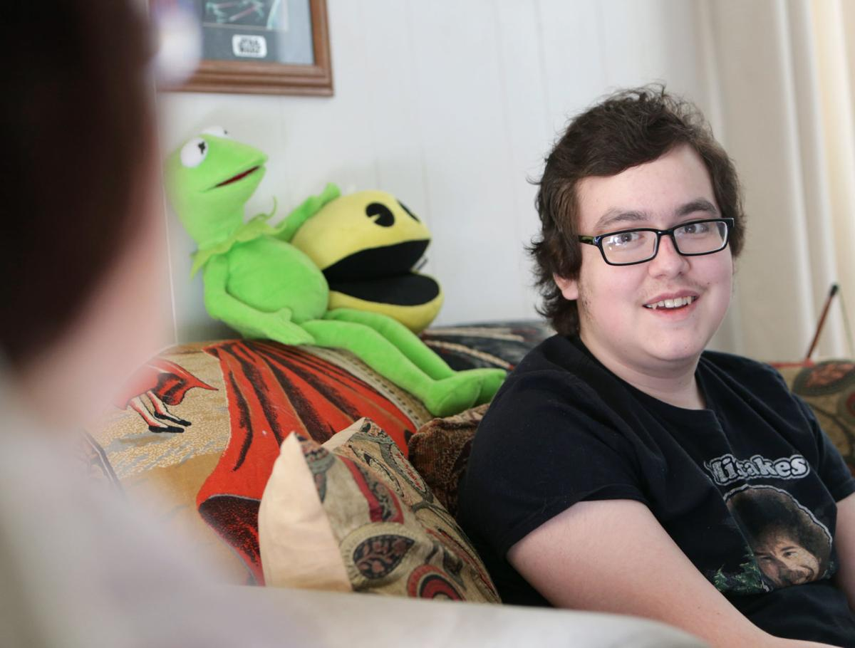 Sebastian at home, with Kermit
