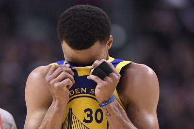 Stephen Curry head in jersey, AP photo