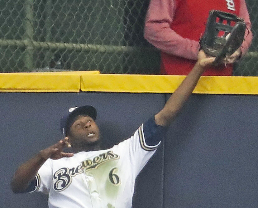 Lorenzo Cain robs homer to win opener, AP photo