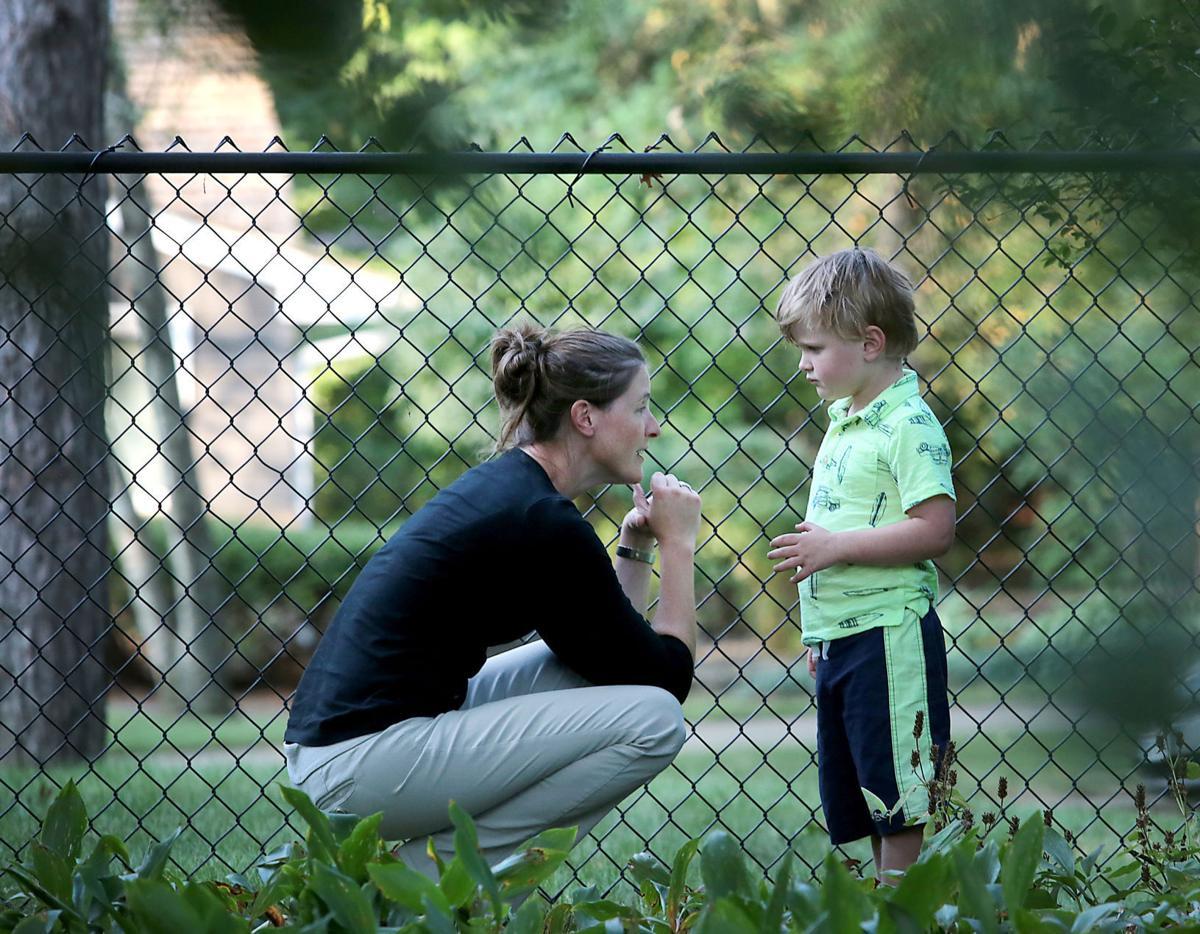Jennifer with Jay by fence