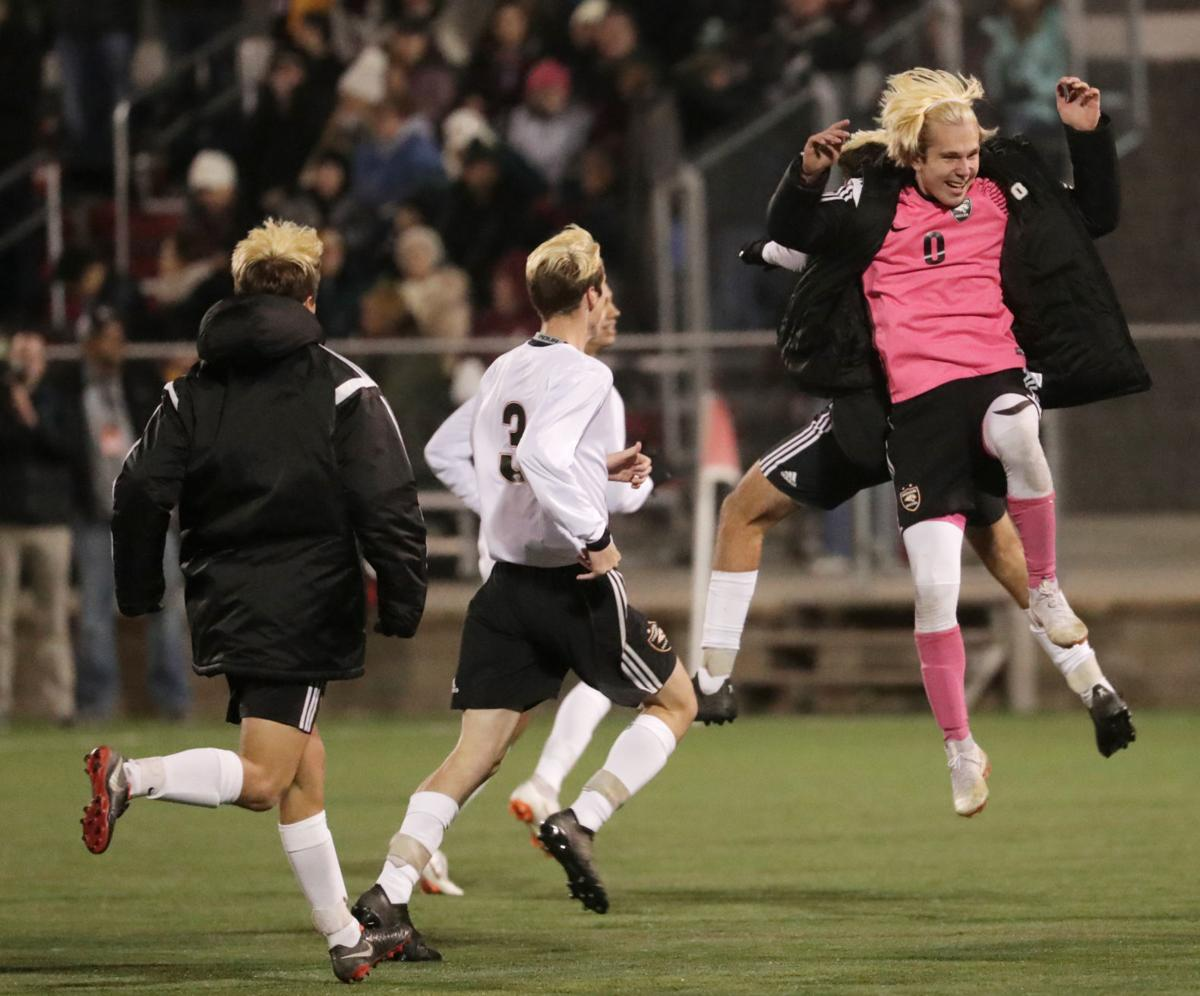 WIAA state boys soccer: Duncan Morgan leads the celebration after Oregon's victory